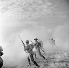 THE CAMPAIGN IN NORTH AFRICA 1940-1943: EL ALAMEIN 1942. British infantry rushes an enemy strong point through the dust and smoke of enemy shell fire.