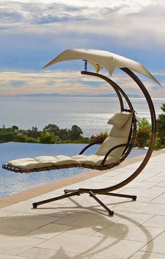 Outdoor swing lounge // with built-in umbrella... I'll have the view, too! #furniture_design
