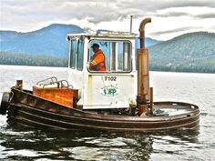 """These little tugs are common up here in the Pacific Northwest. They are often called """"Log Broncs"""", and are used for sorting and marshaling floating timber. They are powered by a single diesel engine, and often have an azimuthing propulsion unit."""