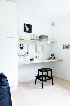 Monochrome home office space with an IKEA stool
