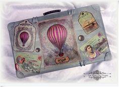 Balony i stare dwupłatowce w towarzystwie dam i gentlemanów na starej walizce decoupage.