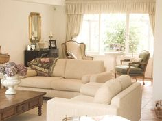 Like this couch, modern but blends well with the french country accents...