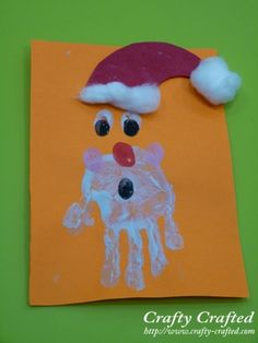 Santa from handprint and thumbprints for mouth, nose and background of eyes