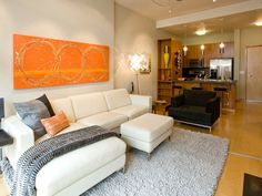 Carrot-colored artwork adds a vibrancy to this otherwise neutral contemporary living room. (http://www.hgtv.com/designers-portfolio/room/contemporary/living-rooms/4125/index.html?soc=Pinterest)