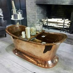 Rustic copper bath tub, amazing.