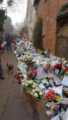 George Michael's home in Goring, England. Goring on the Thames. A sea of flowers, notes, cards and pictures in honor of George. RIP 6-25-1963 to 12-25-2016.