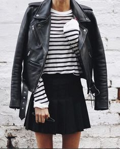 This outfit has been around for a few seasons now, and doesn't show signs of stopping!  An A line black skirt with the sweater, a black collared shirt, black tights, and cargo boots.  Or, wear it with stretch leggings or faux leather leggings with ankle b
