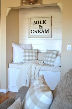 Cozy farmhouse reading nook in living room.