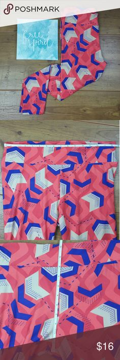 Lularoe Arrow TC leggings Lularoe Arrow TC leggings . Bright pink and blue with arrow shape design. Pre owned in good used condition.   Thanks for checking out my closet and Don't forget to LIKE for a special offer! ! BUNDLE your likes and I'll send you a discount! LuLaRoe Pants Leggings