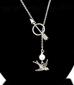 """Not that I'm a Hunger Games nerd, but this necklace is pretty. It was sold on Etsy by """"Starzjewelry."""" Great idea!"""