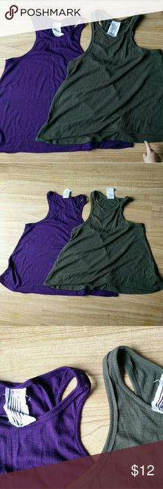 Set of two loose fitting tank tops Set of two loose fitting rib knit tank tops. Very popular racer back style. Great as lounge wear, super comfy for running errands or layering with workout wear. One dark grey, one purple, both in size medium Free People Tops Tank Tops