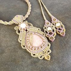 This gorgeous muted pastel macrame pendant features a soft Peruvian pink opal cabochon and a faceted mother of pearl bead. The pendant and necklace are accented with silver lined seeds beads in light amber. The kumihimo necklace closes with a macrame sliding knot so it can be worn shot or