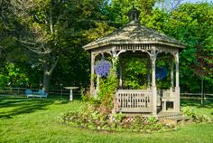 Rustic natural wood octagon gazebo set in a garden
