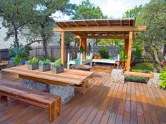"""A cedar pergola at the far side of a huge deck """"sandwiches"""" in the dining and play area while still allowing lots of light into the home."""