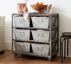 Slatted wood shelves and riveted corner braces enhance the Turlock Storage Table's rustic industrial character. Add our Galvanized Nesting Bins (sold separately) for more organization options; Storage Hacks, Toy Storage, Small Bedroom Organization, Living Room Themes, Small Stool, Industrial Farmhouse, Farmhouse Design, Table Storage, Decorating On A Budget