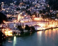 Nainital is a popular hill station in the state of Uttaranchal. It is situated at an altitude of 1900 kilometers above sea level. It is located at 29 degree 24' north latitude and 79 degree 28' east longitude. The best time to visit the place is during summers and the spring season. Initially, Nainital was nothing but a thick, dense forest and was home to the tribes of Kumaoni race. It was discovered and converted into a hill station by the British in 1839