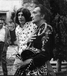 Salvador Dalí | Portrait of the artist carrying a crooked stick and leopard-skin coat with Marc Antoine (ca. 1960) | Available for Sale | Artsy