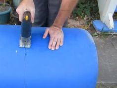 Build a self-watering container garden from a 55 gallon barrel (video)