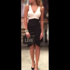 Black and white little dress with cut outs New and not used. Can't go wrong with a classic black and white combo. No trades.zipper in the back Dresses Midi
