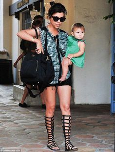 6af907f9c14c Seen on Celebrity Style Guide  Kourtney Kardashian wore tall Gladiator  Sandals