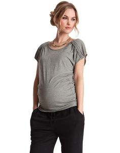 This shimmering chic nursing top is made in soft green stretch jersey with just a hint of sparkle. The shoulders are stylishly ruched, which helps to disguise cleverly concealed zips for easy access nursing. This glittering maternity and nursing top is designed to grow with you throughout your nine months of pregnancy, and ...