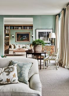 A reconfigured apartment with timeless decor and a refreshing colour scheme | Belle Chelsea Textiles, Georgian Mansion, Melbourne House, Lakefront Homes, Large Artwork, Custom Sofa, Australian Homes, Sofa Covers, Apartment Design