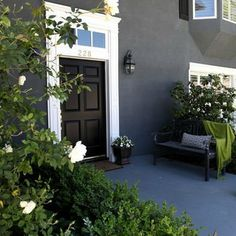 "LOVE the dark stucco and black door set against the contrast of the white trim ""The house is stucco and is painted with Benjamin Moore colors – a dark grey with black undertones"