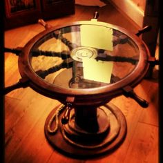 ship's wheel coffee table Made by a very talented friend. Furniture Projects, Home Projects, Beach Mirror, Boat Shelf, Tiki Hut, Ship Wheel, Beach Room, Beach Ideas, Beach Crafts