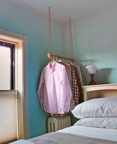 Instead of your standard garment rack, opt for a ceiling rope-hung rack instead.