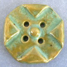 Verde cross pattern vintage ceramic button.