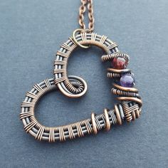 This amethyst and garnet copper heart pendant might make a pretty good gift ;)