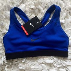 NIKE Dri-Fit Sports Bra NIKE dri-fit sports bra - Medium support! BRAND NEW WITH TAGS!  OFFERS ALWAYS ACCEPTED          NO TRADES Nike Intimates & Sleepwear Bras