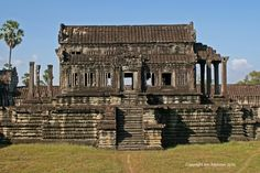 Library, Angkor Wat, Cambodia: One of the two libraries within the Angkor Wat complex is located towards the South Western corner. The roof is intact and constructed from carved stone tiles.