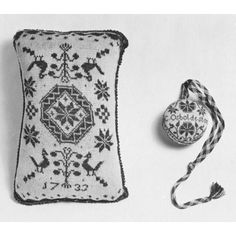 Pin cushion & pin ball, knitted silk-- 1733 (cushion) pin ball 18th century. Great Britain, V&A