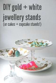 Easy DIY gold and white jewellery stands made with white plates, candlesticks, and a gold Sharpie pen- paint pen. Modern cross/plus sign pattern.