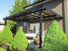 Aménagement terrasse avec auvent en bois, plexiglas ou aluminium