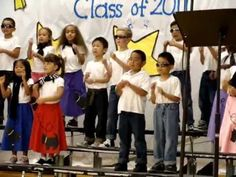 "Zac is performing at his kindergarten graduation. They changed the lyrics to the Grease song ""Summer Love""."