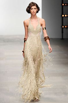 Mark Fast Spring 2012 collection. Crochet triangle-top halter dress in nude with fringed skirt. Sexy!