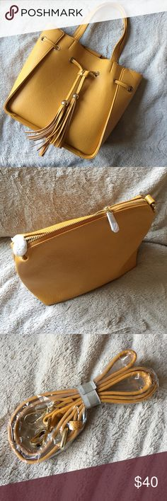 2 in 1 Yellow Shoulder Bag NWT. Beautiful mustard yellow shoulder bag. Comes with plain yellow bag inside that can be made into its own Crossbody!! Charming Charlie Bags Shoulder Bags