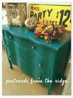 Dark turquoise painted chest of drawers.
