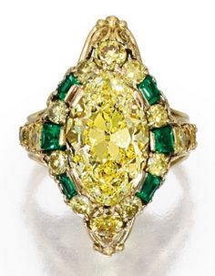 Gold, Fancy Intense Yellow Diamond and Emerald Ring, Designed by Louis Comfort Tiffany. Centring a marquise-shaped Fancy Intense Yellow diamond weighing 4.37 carats, framed and flanked by 16 round diamonds of yellow hue weighing approximately 1.25 carats, accented by six calibré-cut emeralds, signed Tiffany & Co.; 1915-1920. #LouisComfort #Tiffany #ArtsCrafts #ring