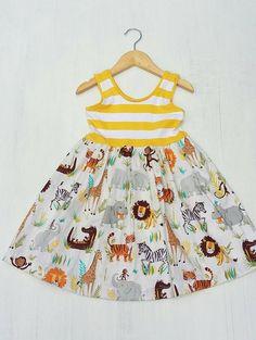 Adorable girls zoo animal dress. Yellow striped jersey knit with safari and jungle animals. Super cute! Love the tigers and elephants! Handmade in hawaii by big island kidz. Etsy.com/shop/bigislandkidz