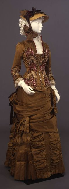 Dress in two parts (bodice and skirt), by Sartoria Giabbani, Florence, c. 1881, at the Pitti Palace Costume Gallery. Via Europeana Fashion.