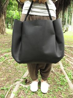 Hand-stitched Matte Black Leather Double Strapped Shoulder Bag  http://www.etsy.com/listing/70551794/hand-stitched-matte-black-leather-double?ref=correlated_featured