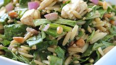 Orzo pasta is tossed with spinach, red onion, feta cheese, pine nuts, basil, olive oil and balsamic vinegar, creating a delicious, colorful cold salad.