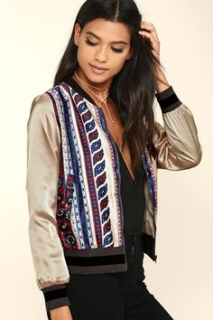 Show off your unique style in the City Festival Beige Satin Print Bomber Jacket! Silky woven poly fabric in a cool beige, blue, and red striped print decorates this classic bomber jacket, with thick black and grey ribbed knit around the cuffs, collar, and waist. Antiqued gold zipper front with diagonal pockets.