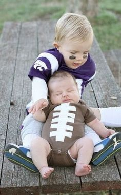 I think I found the girls Halloween costumes for this year! Reese can be a cheerleader, Rian a football, and If we are back in Alaska Riley could be a football player :)