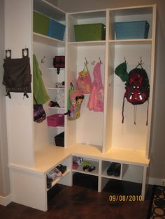 corner mudroom storage.  This is much like what I just drew up for my mud room!!  Awesome to see one like it.