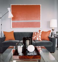 grey walls, grey couch, orange accents.  SO my style.