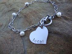 Sterling Silver Hand Stamped Heart Disc Tag Toggle Bracelet. $30.00, via Etsy.